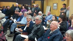 Image of people at a CAPT meeting at City Hall