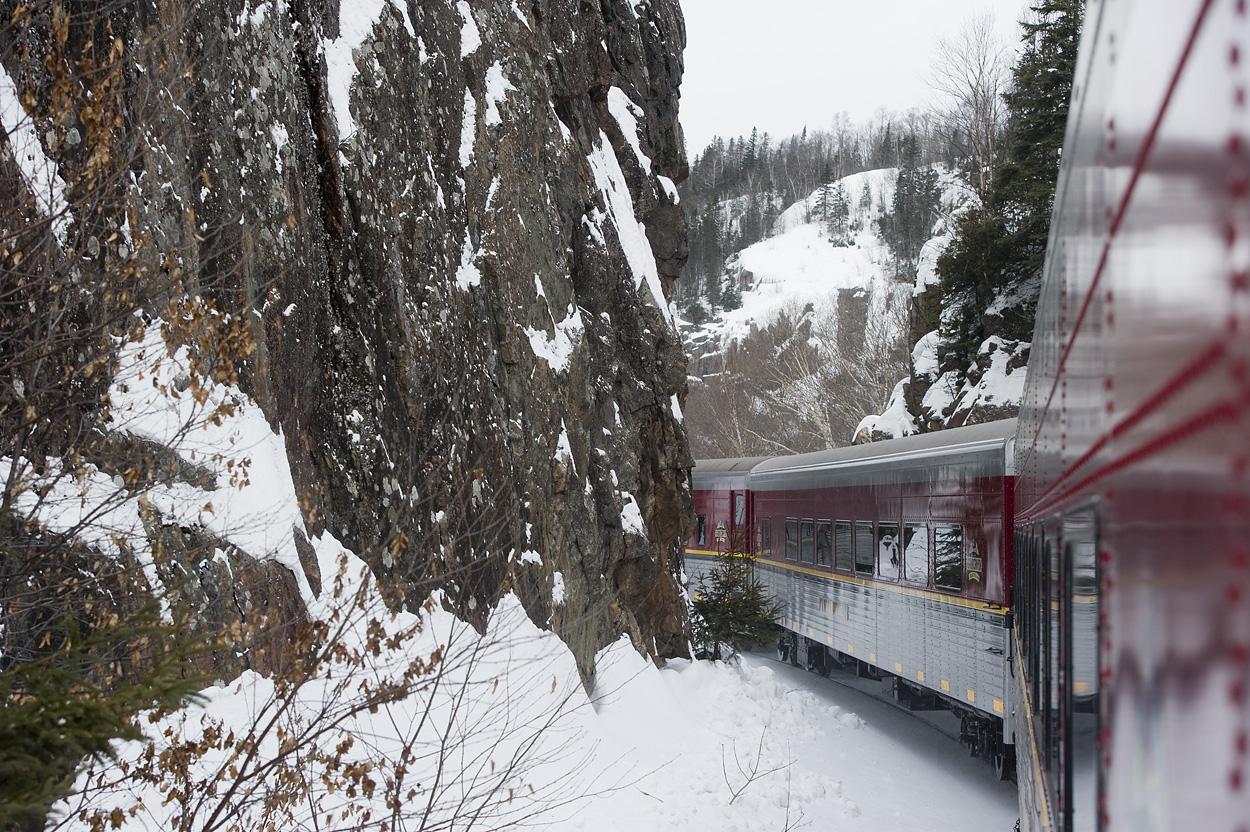 Image of train passing ice on cliffs.
